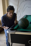 Dilemma, Big Problems. An impossible game of pool.  One of the balls is a basketball, which, off course, is too big for pool.  What to do in these situations Stock Image