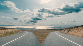 Free Dilemma With Mountain Roads Spliting In Two Ways Royalty Free Stock Image - 91023516