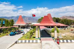 Presidente Nicolau Lobato - Comoro International Airport of Dili, Timor-Leste with national Timorese flag flying. Red roofs. royalty free stock photos