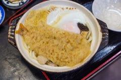 Delicious shrimp tempura udon with egg -  Japanese food. Delicious shrimp tempura udon with egg - Japanese food stock photos