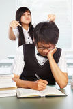 Diligent and bad students Stock Photo