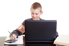 Diligent child learning with laptop Royalty Free Stock Image