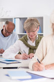 Diligent elderly student Stock Image