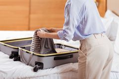 Diligent gorgeous female body while packing her cloth Royalty Free Stock Image
