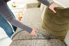 Diligent hand of housewife vacuuming dust Royalty Free Stock Photos