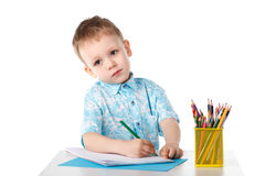 Diligent little boy draws with crayons Royalty Free Stock Images