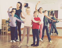 Diligent little boys and girls dancing pair dance Stock Photo