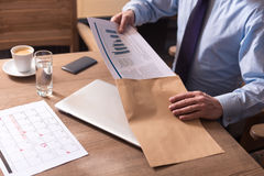 Diligent male office worker packing the documents Royalty Free Stock Photos