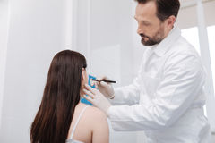 Diligent mindful plastic surgeon applying precise guidelines Royalty Free Stock Photos