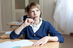 Diligent preschool sitting at desk Stock Photography