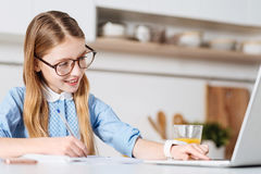 Diligent pretty student searching for some useful tips online Stock Image