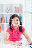 Diligent schoolgirl Stock Photos