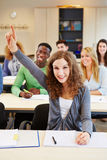 Diligent student raising hand royalty free stock photography
