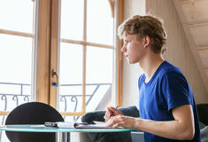 Diligent student doing homework using Tablet Royalty Free Stock Image