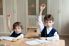 Diligent student sitting at desk, classroom Royalty Free Stock Images