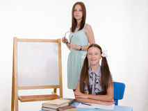 Diligent student and thoughtful teacher Royalty Free Stock Photos