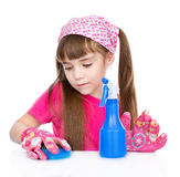 Diligent young girl is tidying up the house. Royalty Free Stock Images