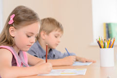 Diligent young learners. Stock Images