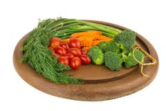 dill. baby tomatoes. carrot. broccoli. on old chopping borad woo stock photo