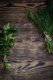 Dill bunch on rustic wood background. Stock Photo