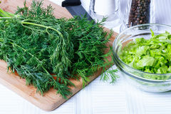 Dill on a cutting board Royalty Free Stock Image