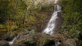 Dill Falls Waterfall. Dill Falls is a scenic 65 foot waterfall not far from the Blue Ridge Parkway in North Carolina.Seen here in autumn stock photos