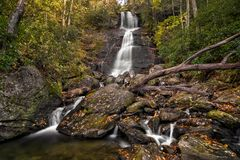 Dill Falls Waterfall. Dill Falls is a scenic 65 foot waterfall not far from the Blue Ridge Parkway in North Carolina. Seen here in autumn stock photos