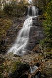 Dill Falls Waterfall. Dill Falls is a scenic 65 foot waterfall not far from the Blue Ridge Parkway in North Carolina.Seen here in autumn royalty free stock images