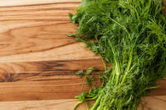 Dill. Fresh dill on cutting board with room to type stock images