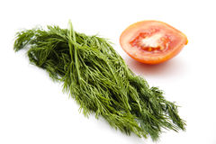 Dill with half a tomato Royalty Free Stock Photo