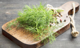 Dill Herb Bunch on a Cutting Board Royalty Free Stock Photos
