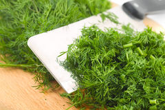Dill on kitchen board Royalty Free Stock Photography