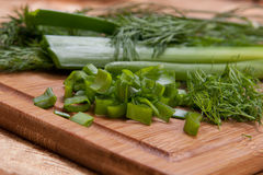 Dill, parsley on chopping board Royalty Free Stock Images