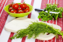 Dill and parsley and tomatoes Stock Photos