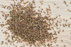 Dill seed on plank Stock Image