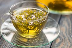Dill tea. Herbal tea with dill in a glass cup outdoors royalty free stock photos