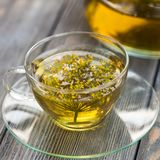 Dill tea. Herbal tea with dill in a glass cup outdoors stock photography