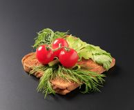 Dill and tomatoes on toast Stock Photo