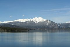 Dillon Lake. A beautiful view of Dillon Lake with the snow-covered Rocky mountains in the background stock photography