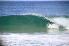 Dillon Perillo. Peniche, Portugal - 2012 October 13: Dillon Perillo tube riding a wave in round 1 at WCT contest, Rip Curl Pro Peniche, Portugal 13 October 2012 royalty free stock photo
