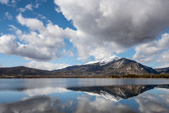 Dillon Reservoir in Colorado with cloud reflection and snow capp Stock Photos
