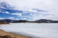 Frozen but extremely scenic and serene Lake Dillon in early spring, Colorado, USA. Dillon Reservoir, sometimes referred to as Lake Dillon, is a large fresh water royalty free stock photos