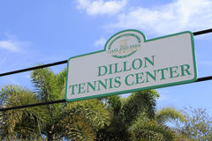 Dillon Tennis Center Sign Outside. Oakland Park, FL, USA - November 12, 2016: Oakland Park Dillon Tennis Center sign outdoors on a sign post near palm trees royalty free stock photos