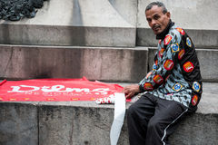 Dilma Rousseff Campaign. Rio de Janeiro, Brazil – October 2014: a man in Praza Floriano Peixoto with stickers and a flag makes campaign for Dilma Rousseff Stock Photo