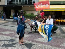 Dilma Rousseff vs Aecio Neves campaign. Rio de Janeiro, Brazil – October 2014: Dilma Rousseff vs Aecio Neves campaign. An unknown man holds Dilma's flag. An Royalty Free Stock Photo