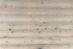 Dim light brown wooden background Royalty Free Stock Images
