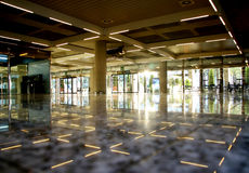 Dim open area in airport    Royalty Free Stock Images