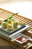 Dim sum. Several dim sum placed on an authentic plate royalty free stock photo