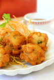 Dim Sum. Deep fried chicken balls with chopped chestnuts served at a Chinese Dim Sum restaurant stock image