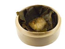Dim sum in a lotus leaf. Closeup of dim sum wrapped in a lotus leaf on a white background stock images